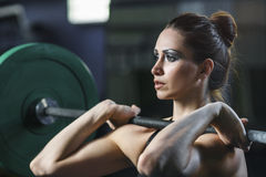 Powerful attractive muscular woman CrossFit trainer do workout with barbell royalty free stock photography