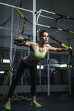Powerful attractive muscular woman CrossFit trainer working out at gym royalty free stock image