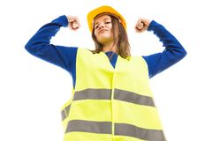 Powerful young female architect rising arms. Powerful attractive young female architect or engineer rising arms as strong successful attitude isolated on white stock photo