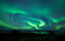 Powerful Aurora across nightsky Stock Photos