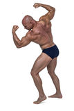 Powerful bald man flexing muscles Royalty Free Stock Images