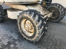 Powerful big wheels with tread and tires of off-road construction equipment, tractors, cars.  royalty free stock images