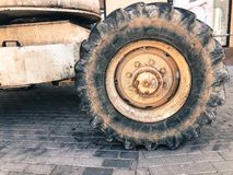 Powerful big wheels with tread and tires of off-road construction equipment, tractors, cars.  royalty free stock photo