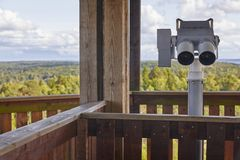 Powerful binoculars on a finnish forest viewpoint. Nature survei Royalty Free Stock Photo