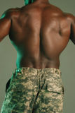Powerful black back military. African American male very muscular back in camo outfit Stock Image