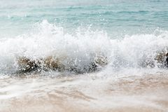 Powerful blue wave breaks along the shore. Close up.  royalty free stock images