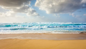 Powerful blue waves of Hawaii. A wide view of large, powerful blue waves rolling in to Sunset Beach on a warm summer day on the North Shore of Oahu, Hawaii Royalty Free Stock Photos