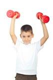 Powerful boy lifting dumbbel Royalty Free Stock Photo