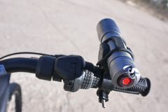 Powerful and bright flashlight running on batteries. Lantern special mount to be able to fix it on the handlebar stock photo