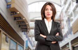 Powerful business woman. Powerful, confident CEO business woman in company headquarters Stock Photography