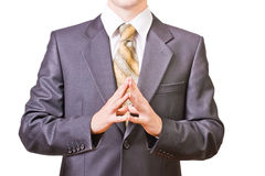 Powerful businessman folds hands together. Powerful businessman dressed in black suit folds hands together Royalty Free Stock Photo