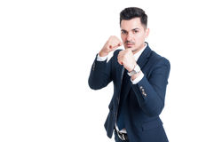 Powerful businessman or salesman with fists ready Stock Photo