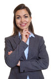 Powerful businesswoman with brown hair looking at camera Stock Images