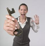Powerful businesswoman holding key of success. Portrait of a very excited woman holding key of success. Conceptual Royalty Free Stock Photo