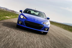 Powerful car on race way. Motion capture. Stock Images