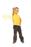 Powerful child boy with bee wings. Showing fist isolated on white background Stock Image