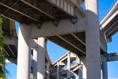Powerful concrete support curved Interlacing highways overpass Royalty Free Stock Photo