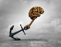 Powerful Decision Idea. Powerful decision and power thinking concept as a human brain made of ropes pulling an anchor with 3D illustration Royalty Free Stock Photography