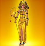 A powerful Egyptian woman. Who has anointed herself pharaoh, walks in a defiant manner, dressed in black and gold. Set on a gold abstract background to enhance Royalty Free Stock Photo