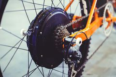 Powerful electric bike motor is installed in the wheel, motor wheel, green technology, environmental care.  stock photo