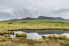 Powerful erupting Mount Aso with little pond in Kumamoto, Japan stock images