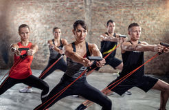 Powerful exercise with resistance band Royalty Free Stock Image