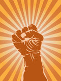 Powerful fist. The symbol of powerful fist on sunray background royalty free illustration