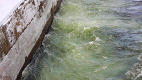 Powerful flow of water in the canal hydropower. Concrete brink stock video
