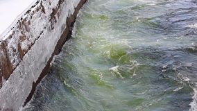 Powerful flow of water in the canal hydropower plant. Concrete brink stock video