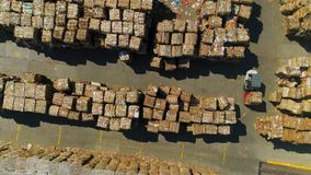 Loader with waste paper drives on storage yard aerial view