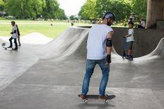 Powerful funny young guys are trained in a skate park Royalty Free Stock Image