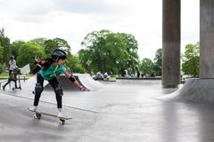 Powerful funny young guys are trained in a skate park Royalty Free Stock Images