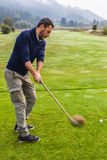 Powerful golf shot. A golf player making a swing on a vibrant beautiful golf course Royalty Free Stock Photo