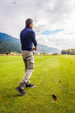 Powerful golf swing. A golf player making a swing on a vibrant beautiful golf course Stock Photography