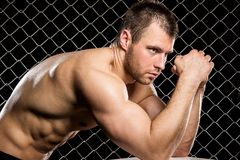 Powerful guy with a chain showing his muscles Stock Images