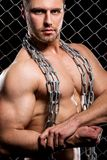 Powerful guy with a chain showing his muscles Stock Photos