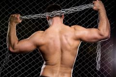 Powerful guy with a chain showing his muscles Stock Photo