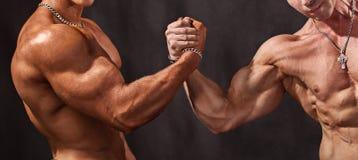 Powerful handshake Stock Images