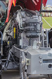 Powerful high-tech tractor engine in modern design. Mounted on a frame with an open hood Stock Image
