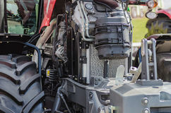 Powerful high-tech tractor engine in modern design. Mounted on a frame with an open hood Royalty Free Stock Photos