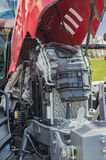 Powerful high-tech tractor engine in modern design. Mounted on a frame with an open hood Royalty Free Stock Images