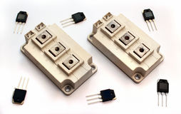 Powerful IGBT transistor modules and small transistors on white Stock Photography