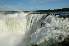 Raging Iguazu Falls, Argentina under rainbow royalty free stock photography