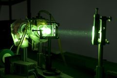 Powerful industrial green LASER for research. Powerful industrial green laser equipment in a laboratory for physics research. Solid State Physics lab. Light Royalty Free Stock Photo