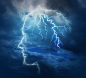 Powerful Intelligence. With an electric lightning bolt strike in the shape of a human head illuminated on a storm cloud night sky as a brain function neurology Stock Images
