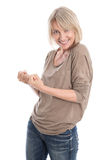 Powerful isolated older blond woman making fist gesture with her royalty free stock images