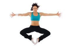 Powerful jump. A beautiful fitness with flat ABs in a high jump of power Stock Image