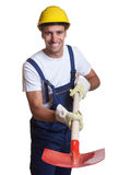Powerful latin construction worker with shovel Stock Image