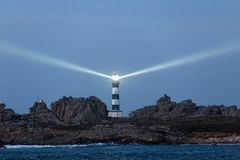 Powerful lighthouse illuminated Royalty Free Stock Images