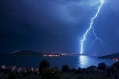Powerful lightning and flashes over Adriatic Sea in Croatia Europe. Storm clouds and hard weather over Adriatic Sea in Croatia Europe. Powerful lightning and stock images